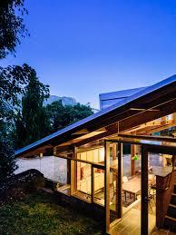 half slope house nestles against a hillside in brazil u0027s