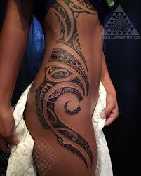 feminine delicate and flowing south seas style tattooing by