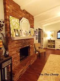 crazy wonderful revere pewter wall with red brick fireplace