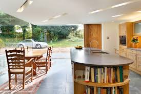 historical english cottage with a cantilevered glazed extension a cantilevered glazed extension by stephen marshall architects kitchen island