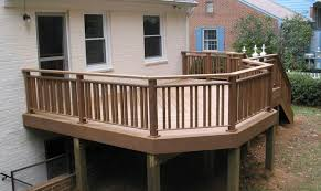wooden deck with stair and deck railing ways to covering a