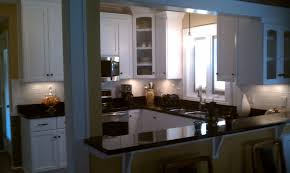 black granite countertop also yellow wall paint decoration with