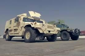 armored humvee banks power sidewinder takes on stock humvee on head 2 head