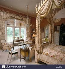 Living Room Curtains Silk Swagged Curtains On Window In Opulent Bedroom With Silk Drapes On