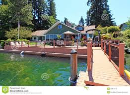lake one story house with dock stock photography image 23617372