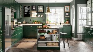 green kitchen cabinets with white island a green fresh and traditional bodbyn kitchen ikea