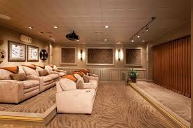 home theater design group raise floor for second sofa theater style basement photos design