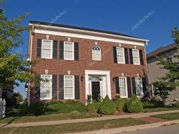 large two story new brick home built to look like an old