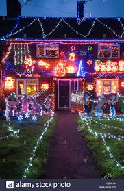 light up xmas decorations exterior of a house lit up with christmas lights at dusk home stock