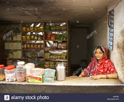 Pantryk He Indian Lady Sitting Behind The Counter Of He Shop In Varanasi