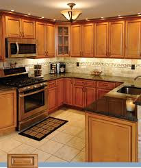 what color backsplash with oak cabinets and black countertops