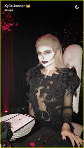 plastic surgery halloween mask kylie jenner hosts epic halloween dinner with tyga u0026 kendall