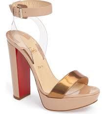 a belted ankle strap appears to float above a gorgeous platform