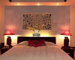 lighting ideas lovely bedroom lighting with yellow shade modern lovely bedroom lighting with yellow shade modern lighting design and floral carved wall above black wooden bedding and two pink cone table lamps on two