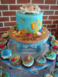 i made this cake and cupcake tower for a under the sea themed baby