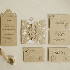 modern bronze laser cut pocket invitations with matching enclosure