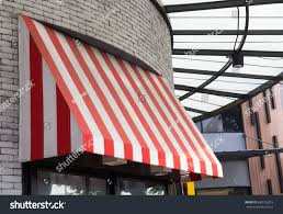 Striped Awning Red White Striped Awning Over Glass Stock Photo 688135216
