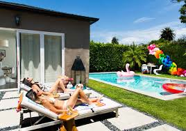 how to throw the ultimate summer party throwing the ultimate summer pool party don t forget your giant pink flamingo float