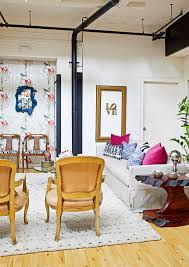 bright bohemian room design with gold accent chairs and tree stump bright bohemian room design with gold accent chairs and tree stump table