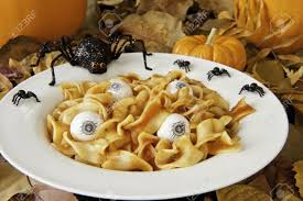 zombie lunch of noodle brains and eyeballs with halloween spiders