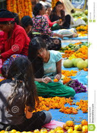 nepalese make garland for sale at thamel market editorial