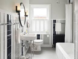 black metal single bathroom wall lighting beside a rounded mirror
