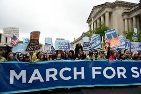 thousands brave the elements to partake in march for science in