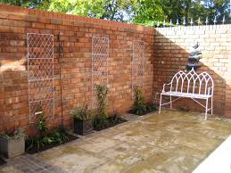Brick Wall by Reclaimed Brick Walls In A Small Courtyard Garden From A Garden