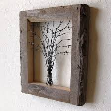 reclaimed barn wood and barbed wire tree wall this is about
