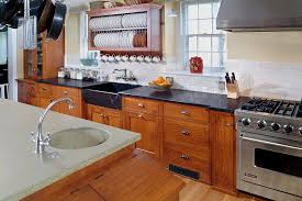 chic dish drying rack in kitchen transitional with behind stove