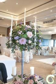 wedding flowers ta top table flowers at the mere silver mercury glass vases and