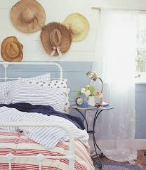 Wrought Iron And Wood Nightstands Coastal Bedroom Ideas With Hats And Wood Paneling Walls And Metal