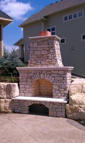 custom outdoor fireplace with our signature two tiered mantel and