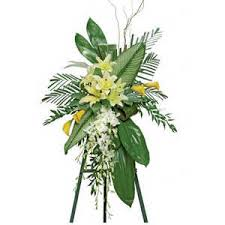 funeral spray lilies orchids and ti leaves standing funeral spray nationwide