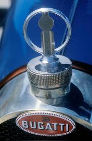 a up of a ornament on a vintage bugatti automobile at