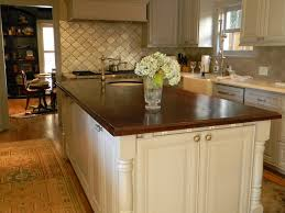white kitchen wood island brown wooden kitchen island counter top on the white wooden base