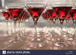 red martini row of red martini glass cocktails stock photo royalty free image