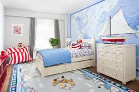 nautical kids bedroom furnished with white furniture and using