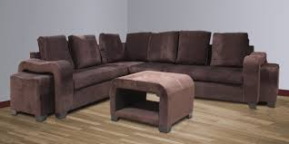 chocolate sectional sofa quanto sectional sofa with 2 pouffes center table in chocolate