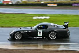 black dodge viper black dodge viper racing flat out in the by stewart