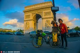 Traveling Around The World images A man and a dog traveling around the world on cycle 1 jpg