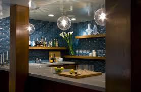 teal ceramic tile backsplash installed in the kitchen with wooden
