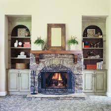 denver stacked stone fireplace bookcase living room mediterranean