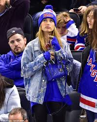 new york rangers fans hailey baldwin shows her colors in ny rangers gear at hockey game