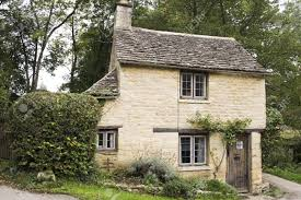 Small Cottage by Small Golden Limestonoe Cottage In The Village Of Bibury In The