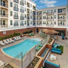 home plans with a courtyard and swimming pool in the center discover the perks of luxury living in downtown baltimore