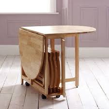 drop leaf table with folding chairs stored inside how to choose dining tables for small spaces small spaces space