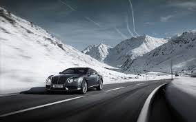 grey bentley grey bentley continental gt v8 on the road in the snowy mountains