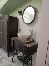 old sewing treadle cabinet upcycled as bathroom vanity for the