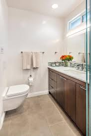 bathroom wood bathroom cabinets over toilet with white granite all images